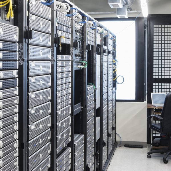 Servers in an aisle of racks in a computer server farm.